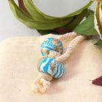 detalle 7 cubiertos de servir rayas turquesa
