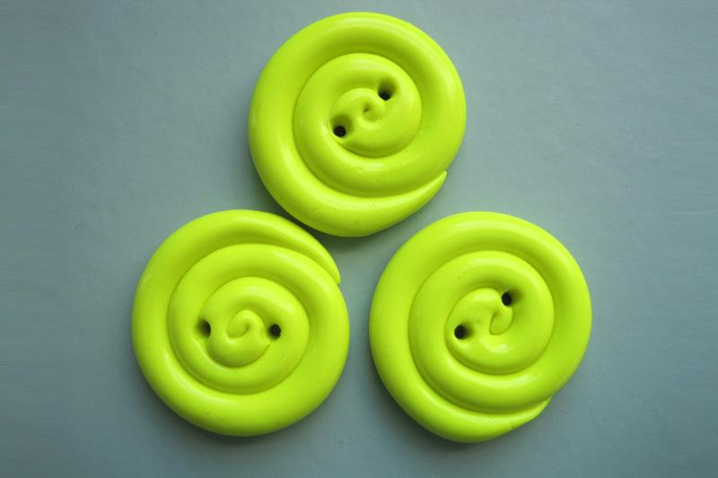 botones amarillo espiral